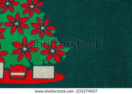 christmas tree carpet on green background - stock photo