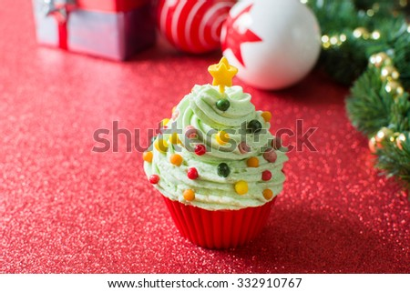 Christmas tree cupcake and Christmas decoration - stock photo