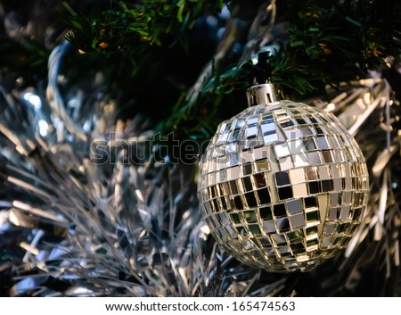 Christmas tree decorated with grungy mirror disco ball. - stock photo