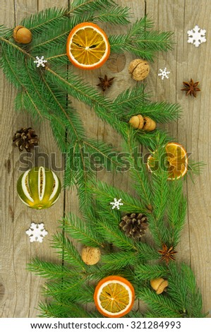 Christmas tree decorated with spices, pine cones and acorns. - stock photo