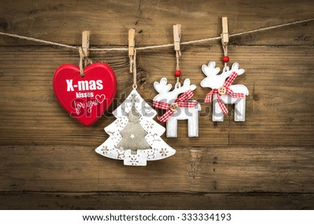 Christmas tree decoration. Copy space. Wooden hearts and stars on a clothesline.  - stock photo