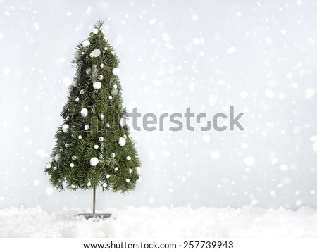 christmas tree decoration in a studio setting - stock photo
