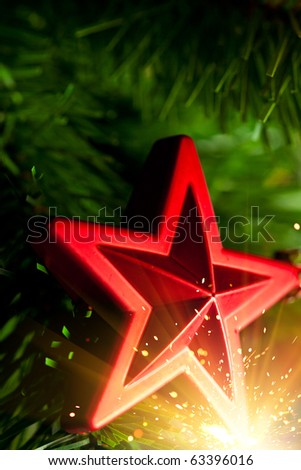 Christmas-tree decoration - red star with glare sparkles - stock photo