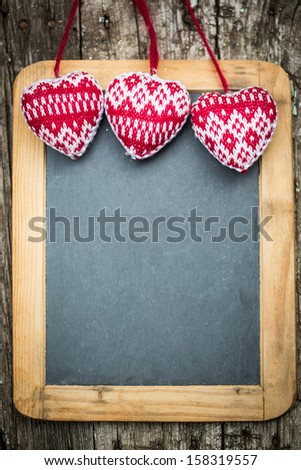 Christmas tree decorations border on vintage wooden blackboard. Winter holidays concept. Copy space for your text - stock photo