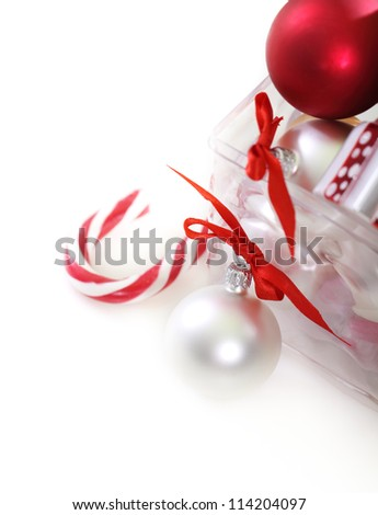 Christmas tree decorations in front of white background - stock photo