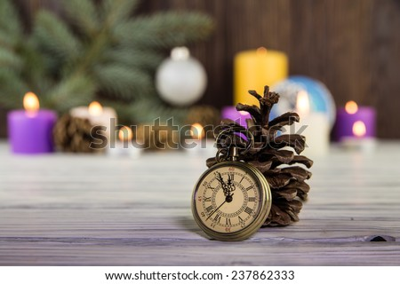 Christmas tree decorations with candles on an old wooden backgro - stock photo