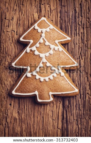 Christmas tree gingerbread cookie on a brown background - stock photo