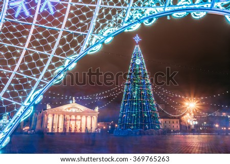 Christmas tree, illuminations and decorations in town Oktyabrskaya Square in central Minsk, Belarus - stock photo
