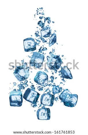Christmas tree in blue water after ice cubes are dropped into it.  - stock photo