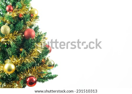 Christmas tree isolated on white with copy space for text. Seasonal image of decorated fir tree for holiday card concept - stock photo