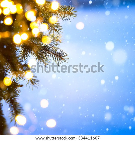 christmas tree lights; blue snow background - stock photo