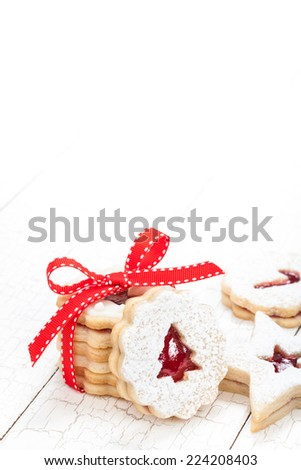Christmas tree linzer cookies with a red bow - stock photo