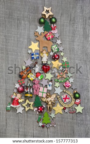 Christmas tree on a wooden background - an idea for a greeting card  - stock photo