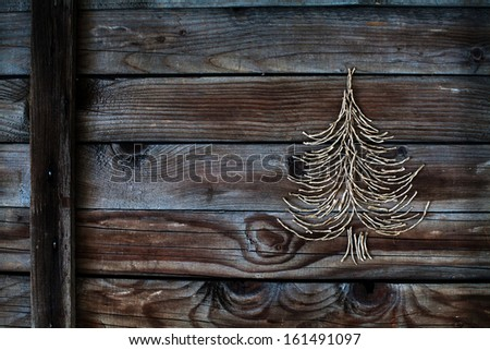 christmas tree on wooden background, new year card - stock photo