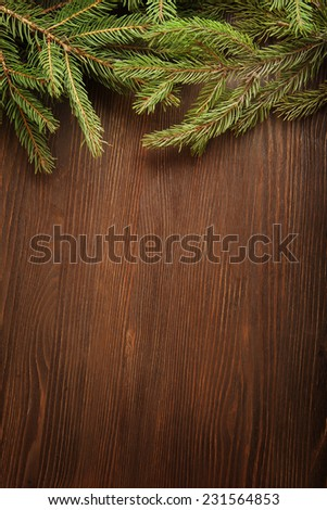 Christmas Tree on wooden background space for lettering - stock photo