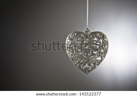 Christmas tree ornament in from of a heart - stock photo