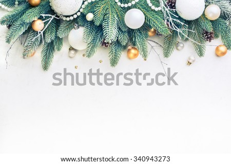 Christmas Tree Pine Branches and Christmas balls on a light background. - stock photo