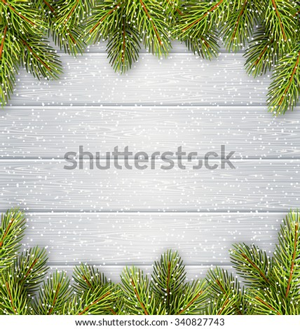 Christmas Tree Pine Branches Like Frame in Snowfall on White Wooden Background - stock photo
