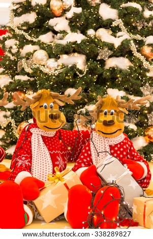Christmas tree, Reindeers preparing presents for Christmas - stock photo