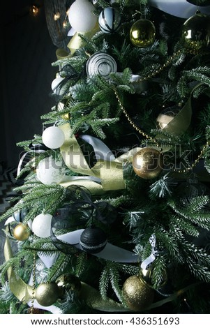 Christmas tree. Silver and golden balls. - stock photo