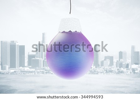 Christmas tree toy - blue ball at city background - stock photo
