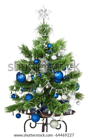 Christmas tree with blue Christmas balls and decoration isolated on white background. - stock photo
