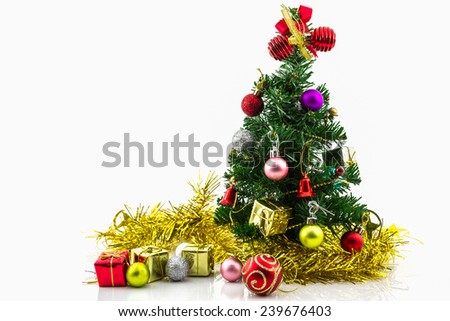 Christmas tree with colorful ornaments on white background. - stock photo