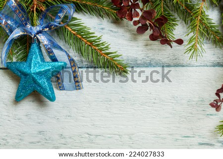 Christmas tree with decoration on a wooden board - stock photo