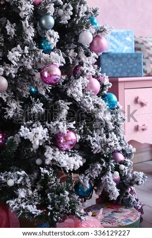 christmas tree with decoration on the pink room background - stock photo