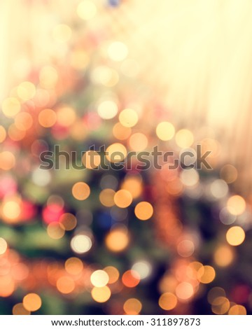 Christmas tree with defocused lights. - stock photo