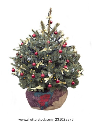 Christmas tree with holiday toys in the bag with the ground  - stock photo