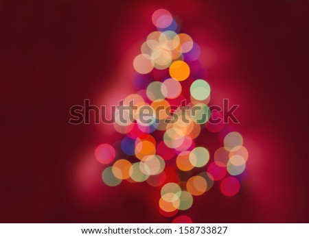 Christmas tree with lights glowing - stock photo