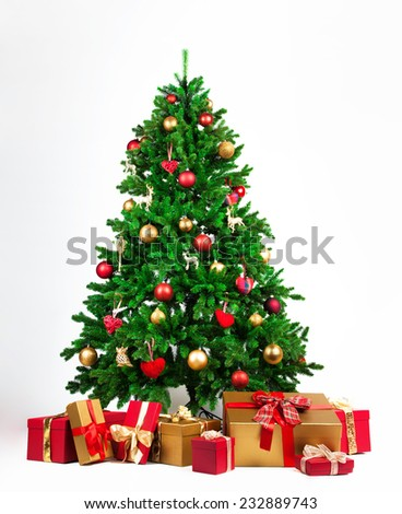 Christmas tree with many presents under it - stock photo