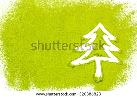 Christmas tree with powdered green tea on white background - stock photo