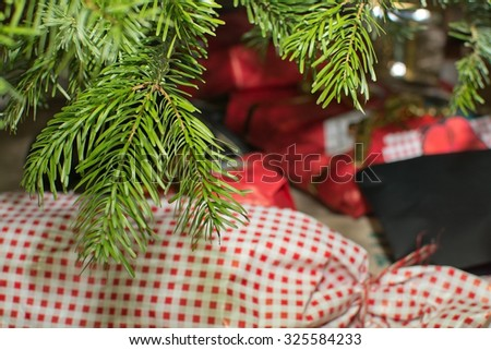 Christmas tree with presents closeup. Christmas tree with traditional decoration closeup, Sweden in December.  - stock photo