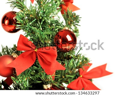 Christmas tree with red ornaments isolated - stock photo