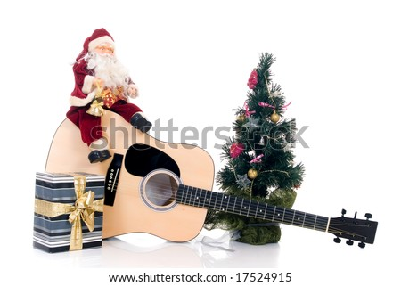 Christmas-tree with Santa Claus sitting on guitar with present, isolated on white background - stock photo