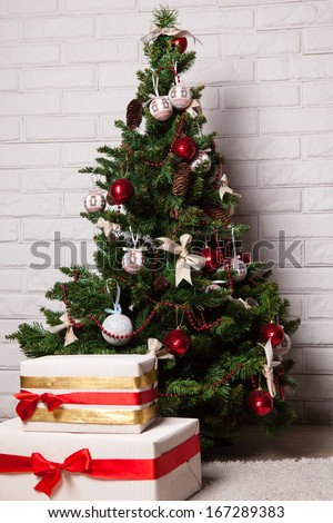 Christmas tree with toys and fancy boxes - stock photo