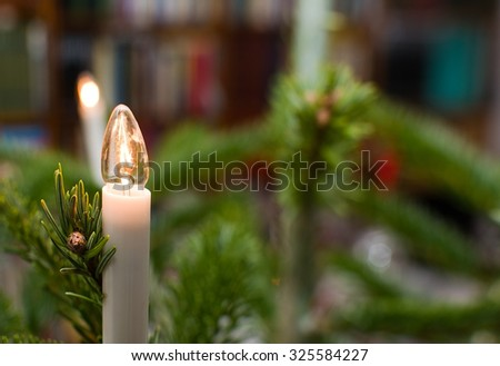 Christmas tree with traditional light decoration closeup, and copy space.  - stock photo