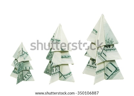 Christmas trees made of hundred dollar bills on a white background - stock photo