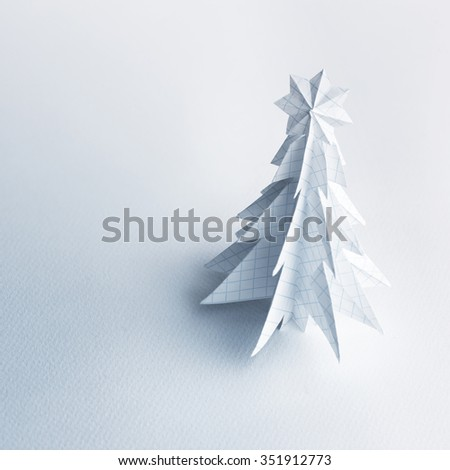 Christmas trees made of paper on white background. Christmas card. - stock photo