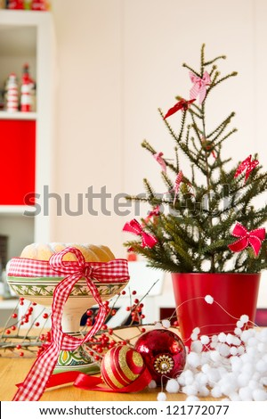 Christmas turban at the table with red decoration - stock photo