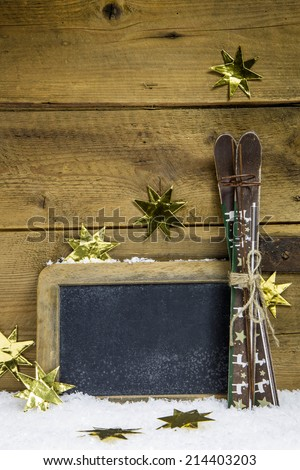 Christmas voucher or wooden sign for winter holidays with ski. - stock photo