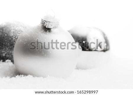 Christmas white glass balls on snow, winter background, frost, glittering lights. - stock photo