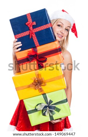 Christmas woman carrying many presents, isolated on white background. - stock photo