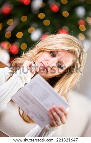 Christmas: Woman Concerned About Holiday Credit Bills - stock photo