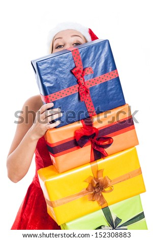 Christmas woman hiding behind many presents, isolated on white background. - stock photo