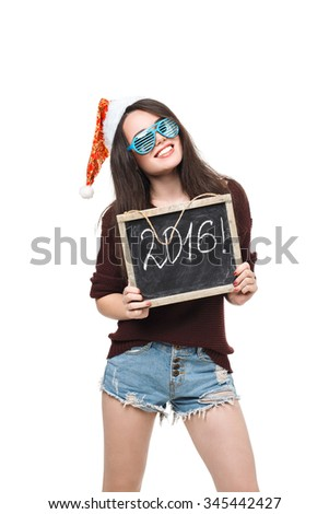 Christmas woman hold card with the word of 2016. Santa hat. Isolated smiling girl.  - stock photo