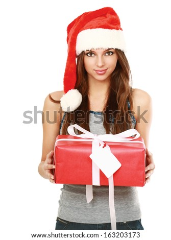 Christmas woman holding gift wearing Santa hat. Isolated on white background - stock photo