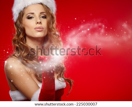 christmas woman on red background - stock photo